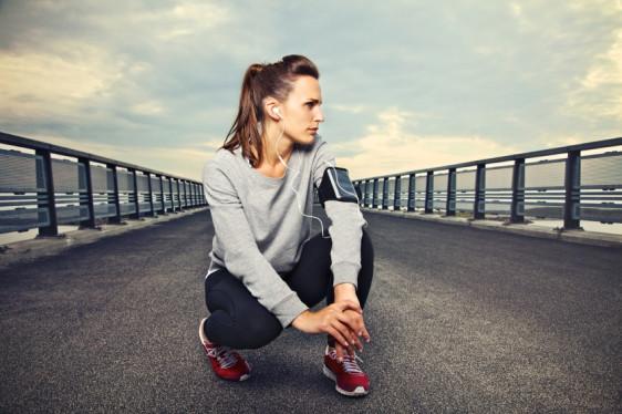 Fitness Runner on the Bridge Resting