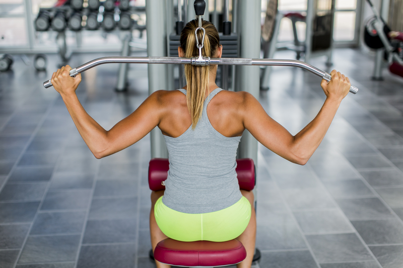 http://www.dreamstime.com/stock-images-young-woman-training-gym-pretty-image43753034