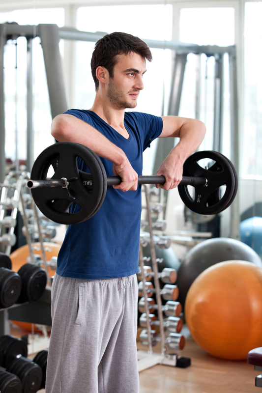 http://www.dreamstime.com/royalty-free-stock-images-young-man-training-gym-image25968449