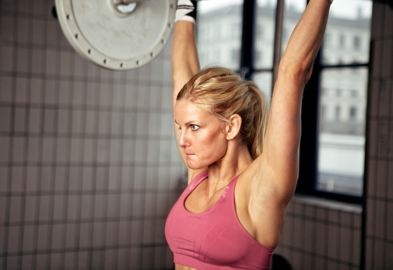 http://www.dreamstime.com/stock-images-concentrated-woman-lifting-weight-image25317454